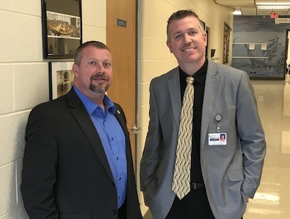Tommy Jones, Sheriff and Dennis Hicks, Principal, discuss a drill conducted at Rural Vale School.