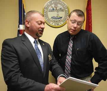 Sheriff Tommy Jones with Detective Doug Mills